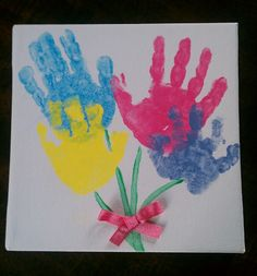 Mothers Day handprint flowers. Used 8x8 canvas, acrylic paint, 4 adorable hands and hot glue on a ribbon.
