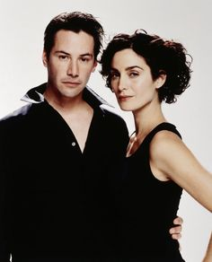 Carrie Anne Moss and Keanu Reeves