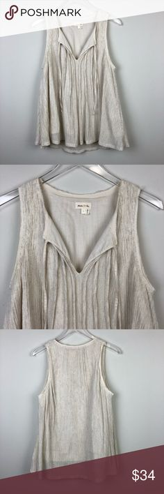 "Anthropologie | Meadow Rue Pleated Tie Neck Tank L Sleeveless Pleated tank. Flowy fit. Tie neck. Lined. By Meadow Rue from Anthropologie.   ▪️Pit to Pit: 19"" ▪️Length: 27"" ▪️Condition: Pre-Owned. Excellent condition.  ▫️A53 Anthropologie Tops Tank Tops"