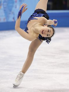 Mao Asada of Japan competes in the women's free skate figure skating finals at the Iceberg Skating Palace during the 2014 Winter Olympics, Thursday, Feb. 20, 2014, in Sochi, Russia. (AP Photo/Bernat Armangue) (2557×3400)