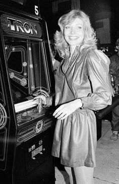 Actress Cindy Morgan with a Tron cabinet game. She played Lora/Yori in the film.