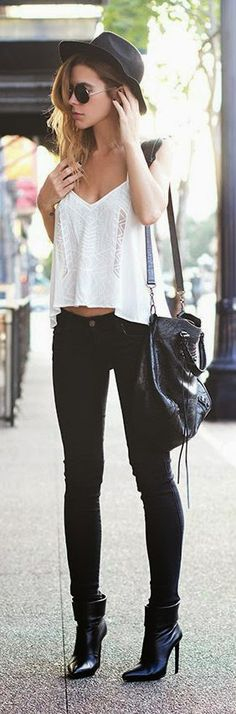 white loose top, black skinny jeans, chic black boots, leather handbag the perfect street chic outfits