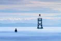 """Stunning Photographs of Antony Gormley's """"Another Place"""" by Paul Sutton"""