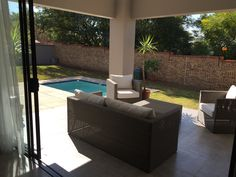 Relaxation spot. Covered patio overlooking pool and garden (under construction) My house