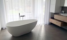 Badeloft's helps turn your bathroom into a spa with stone resin freestanding bathtubs and sinks. Our freestanding tubs are designed to bring elegance and beauty into your bathroom. Request a FREE stone resin material sample today! Stand Alone Tub, Bathroom Goals, Bathroom Design Luxury, Resin Material, Sink Faucets, Luxury Homes, Minimalist, Freestanding Bathtub, Gray