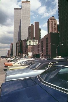 NYC. World Trade Center with lots of colorful 1970s cars by West Street. May 1973. By wavz13