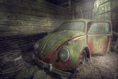 An old Volkswagen Beetle found in an abandoned barn. That's one dead bug! Cool photo.