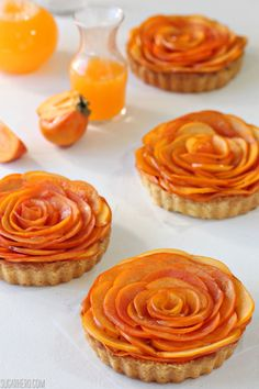 These Persimmon Almond Rosette Tarts are a gorgeous, unique fall dessert! Almond tart dough, almond frangipane, and fresh persimmons make these tarts special. Winter Desserts, Mini Desserts, Just Desserts, Delicious Desserts, Tart Recipes, Fruit Recipes, Dessert Recipes, Sweet Pie, Sweet Tarts