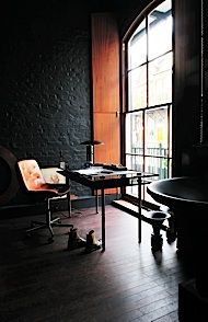vintage industrial eclectic modern loft study with black brick walls. LOVE these black brick walls