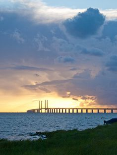 The Öresund Bridge between Sweden and Denmark in the beautiful midsummer sunset.