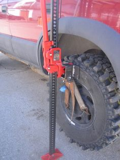 Hi-Lift Jack Accessory - Homemade wheel lift constructed from rectangular tubing, steel plate, nylon strap, hooks, and bolts. Intended for utilization in conjunction with a high-lift jack. Overland Gear, Overland Truck, Patrol Y61, Nissan Patrol, Jeep Mods, Truck Mods, Jeep Xj, Jeep Wrangler, Hi Lift Jack Mount