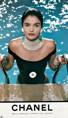 This ad is a perfect example of the jewelry trends in the 90s. Dog collars and chokers were all the rage throughout this decade and what better way for the couture to follow the trend than by making the tight necklaces all pearls.