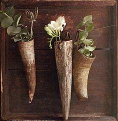 old horn flower sconce. like horns, use fuller flowers
