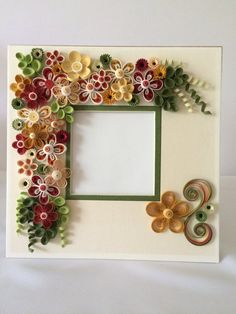 Quilled flowers in shadow box frame