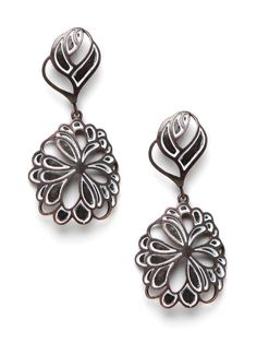 Inspired by French stained glass windows, this striking pair of earrings takes the art form to street-chic terrain with the oxidized silver. The black petals only add to the edge.