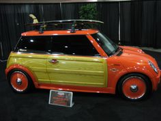 Orange Mini Cooper thing ! , wonder what this stupid thing will cost .