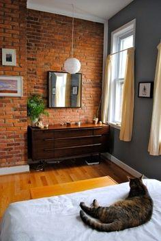 Great mirror size, midcentury dresser, exposed brick, etc.