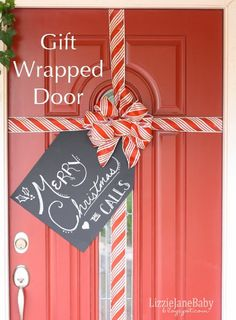 Gift Wrapped Front Door – With Tag - 12 Jolly DIY Door Displays to Greet Christmas Houseguests! | GleamItUp