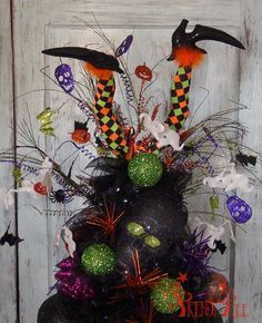 Witch Legs and Halloween Sprays for a tree topper to this tomato cage tree - tutorial at Trendy Tree. http://www.trendytree.com/blog/tomato-cage-halloween-tree-tutorial/