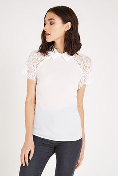 Delicate with lightweight crepe material and vintage-style lace shoulders, the Gelda short-sleeved blouse with a neat collar is a go-to piece for your smartwear wardrobe this summer. Versatile and elegant, dress it down with skinny jeans for a casual drink or up tucked into a pencil skirt for the office. <p></p><li> Top with lace shoulders </li><li> Lightweight crepe </li><li> Short lacy sleeves </li><li> Collar <&#x...