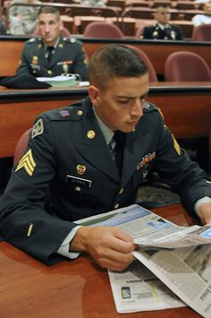 Sgt. Daniel A. Acree, a multi-media illustrator with the 368th Military Intelligence Battalion in Oakland, Calif., peruses the latest newspaper for current events prior to the boardroom and essay portion of the 2010 Army Reserve Best Warrior Competit political campaigns