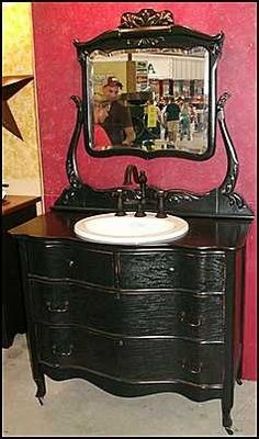 Images On Black dresser as bathroom vanity
