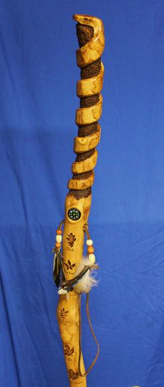 Beautiful hickory hiking stick, I love how they inserted the compass and added the feathers.