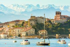 San Vicente de la Barquera, Cantabria This charming fishermen's village is located on the Cantabrian coast – famed for its salty black anchovies – and is nestled between the Atlantic Ocean and the peaks of the Picos de Europa mountains.