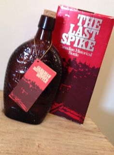 The Last Spike Glass Bottle Amber Embossed by queenbeecanada