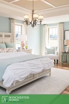 Double-hung windows welcome natural light in to illuminate the beautiful hardwood floors and mint green walls found in the Mason model's owner's bedroom. #InteriorDesign #DreamHome