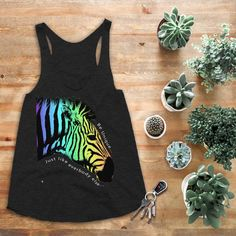 This women's tank top is for the individual. Every zebra looks the same... but every zebra is unique...look closer. Doesn't matter if you're white with black stripes, black with white stripes or even rainbow colored (this zebra should probably ask some questions)...you are unique. This soft comfy tank top is colorful yet fashionable and will go great with any summer outfit. This cute tank top also comes in white :) Graphic Tank Tops, Cute Tank Tops, Black Stripes, Passion For Fashion, Shirt Designs, Summer Outfits, Design Inspiration, Unique, Closer