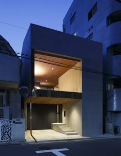 Concrete and fibre-reinforced plastic were used to reduce the cost of building this house.