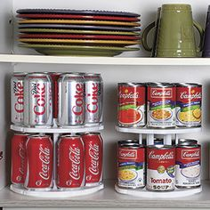 """CAN TAMER.  Quickly organize your cupboard, pantry, countertop or fridge with this two-tier can carousel! Space-saving design holds 13 beverage cans, or up to 39 food cans (up to 2.5""""Diam.) and spins for easy access."""
