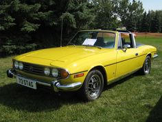 "1970–1977 Envisioned as a luxury sports car, the Triumph Stag was designed to compete directly with the Mercedes-Benz SL class models. All Stags were four-seater convertible coupés, but for structural rigidity – and to meet new American rollover standards of the time – the Stag required a B-pillar ""roll bar"" hoop connected to the windscreen frame by a T-bar. A removable hardtop was a popular factory option for the early Stags, and was later supplied as a standard fitment."