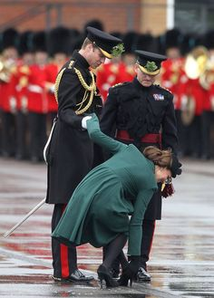 Pin for Later: The Royal Couple's Cutest PDA Moments Prince William was quite the gentleman helping Kate with her shoe in March 2013 in England.