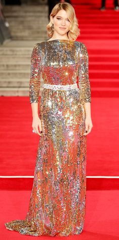 Lea Seydoux sparkled at the Spectre world premiere in an all-over gold-and-silver sequined Prada column that served up blinding mega-wattage shine. She furthered the shine with Chopard yellow diamond earrings.