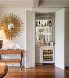 Love this idea! (plus the awesome mirror!) How To Fit a Built-In Bar in a Small Home | Apartment Therapy