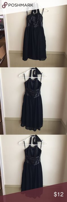Sequin Halter Dress (10) Pretty black flowy dress with sequined top and halter straps. Great for a dance or a semi formal event. Tag size 4. Has been worn, a couple sequins are missing but no noticeable wear. Dresses Midi