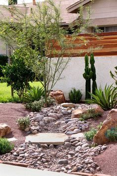 Front yard landscape dry creek bed with a natural for Landscaping rocks austin