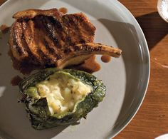 Pork Chops with Chiles Rellenos and Ancho Sauce    Read More http://www.epicurious.com/recipes/food/views/Pork-Chops-with-Chiles-Rellenos-and-Ancho-Sauce-354299#ixzz1wY5VeSdm