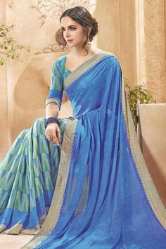 Online saree shopping, Blue georgette diwali saree, u neck blouse now in shop. Andaaz Fashion brings latest designer ethnic wear collection in US