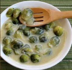 Brussel Sprouts Smothered in DELICIOUS White Sauce made with thyme, cayenne and onion. Make vegan using vegetable broth and almond milk.