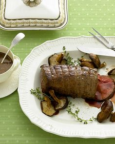 Beef tenderloin roasted with shiitake mushrooms and thyme is impressive. Creamy shallot-brandy sauce is for spooning over the beef; sprigs of thyme tucked underneath hint at one of the flavors.