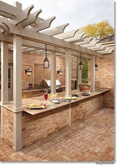 Outdoor kitchen. Love the pergola, but might want something a little more weatherproof over the grill and bar area. #outdoor #kitchen #ideas