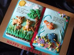 from CakeCentral: This cake was for a 3 yr old girl who could not make up her mind if she wanted Lion King or Nemo.  So her mother asked me to put both on a cake and I came up with the storybook idea...I think it turned out fine!!!  Used a book pan.  All mmf.  Credits for the story on the book (painted) goes to my DH!!