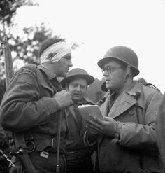 War correspondent Charles Lynch talking to Rifleman Albert Jesson during the attack on the German airport at Carpiquette. 4 July 1944