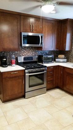LG Gas Range, Kraft Maid Cabinets, Quartz Countertops, Ceramic