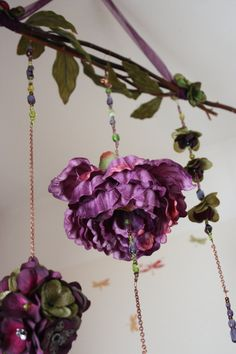 Can't afford, but LOVE: Purple Beaded Floral Nursery Mobile, Etsy.