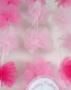 I was browsing the web yesterday and someone mentioned Tulle Pom Poms. Anyway, this Tulle Pom Pom tutorial practically landed in my hands t. Tulle Garland, Tulle Poms, Pom Pom Garland, Tulle Tutu, Pink Tulle, Tulle Balls, Ribbon Garland, Fabric Garland, Tulle Flowers