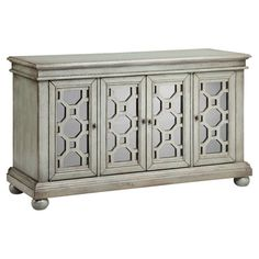 $581 Stow extra table linens and place setting in eye-catching style with this weathered sideboard, featuring mirrored doors with geometric overlay.